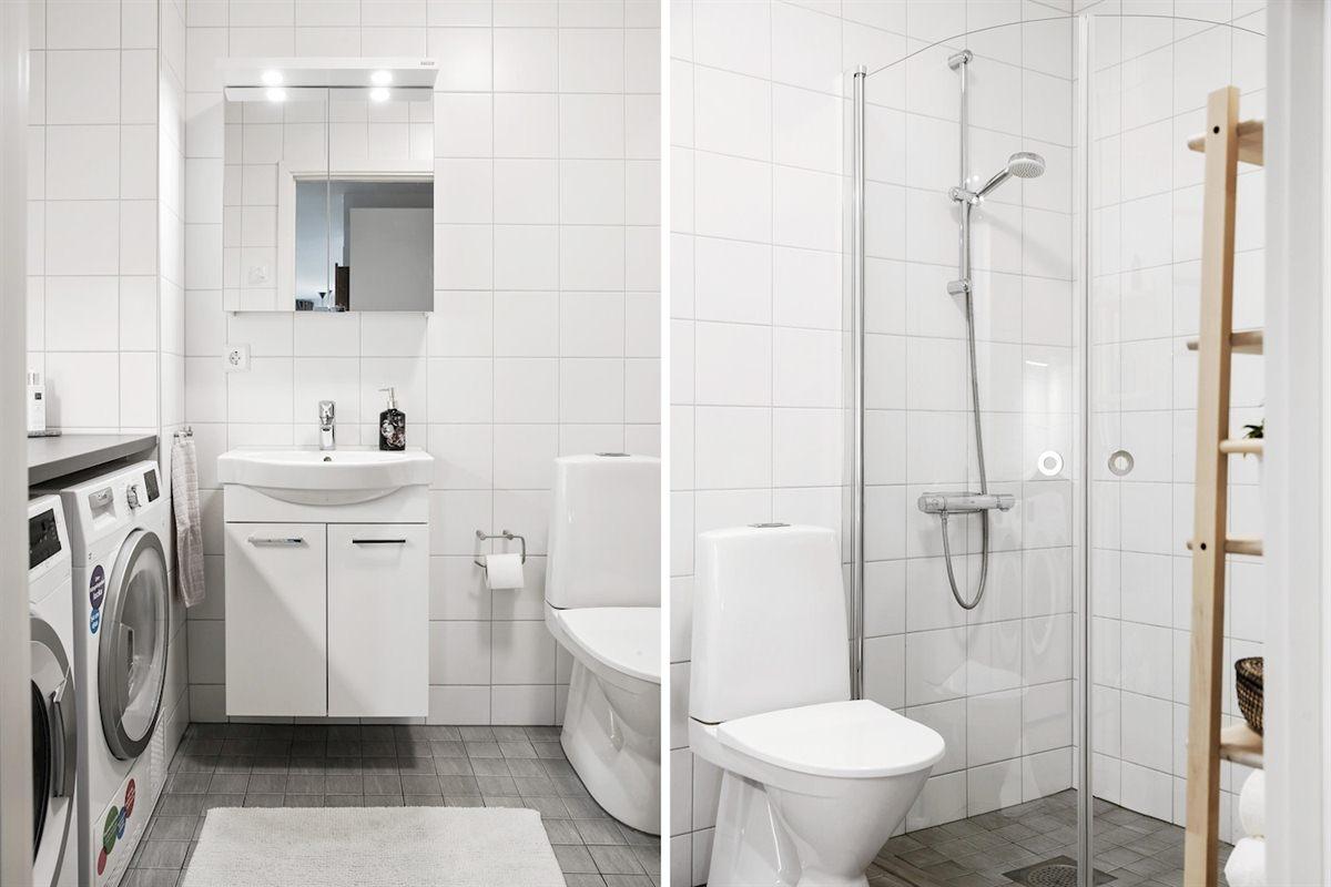 Badrum med dusch och tvättdel.